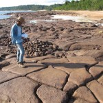 Undergraduate student Tiago Pereira Araújo making a fracture survey in silicified sandstone layers that occur in the Alter do Chão Aquifer, to assess the aquifer's vulnerability. The outcrop is located along the Negro River, a few kilometers northwest from Manaus, Amazonas, Brazil. Photo: Ingo Wahnfried